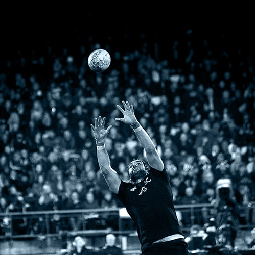 All Blacks player catching rugby ball